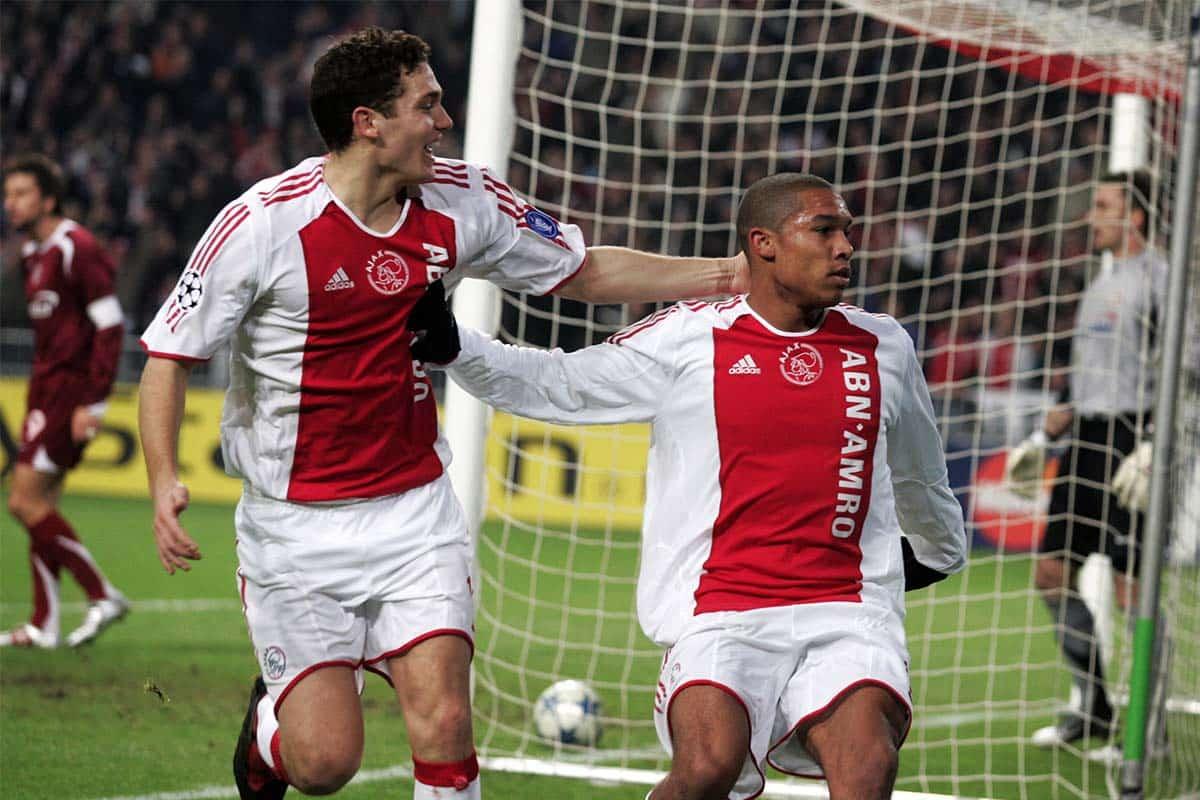 Thomas Vermaelen of Ajax, celebrates the goal of teammate Nigel de Jong