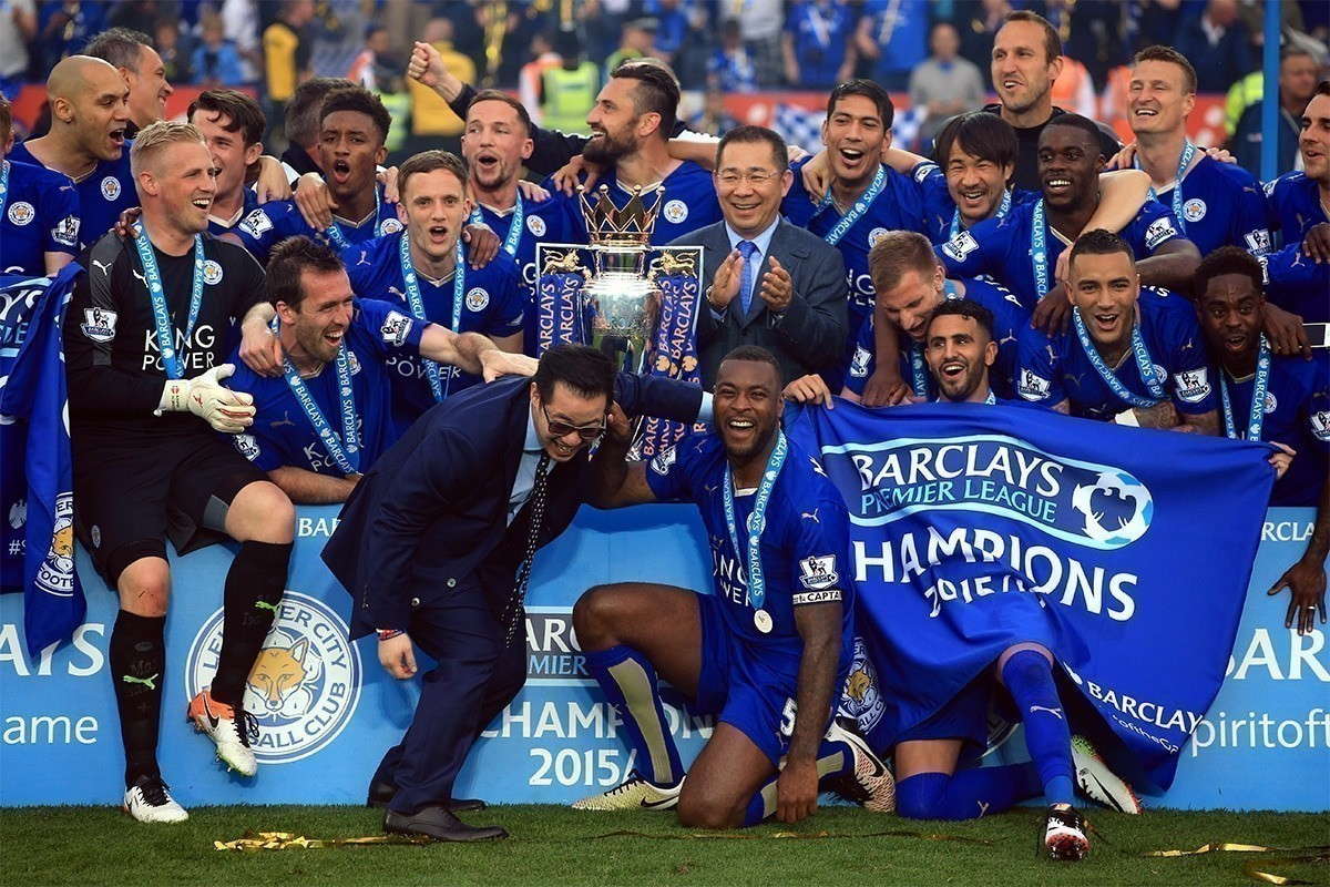 Leicester City celebrate with Premier League trophy
