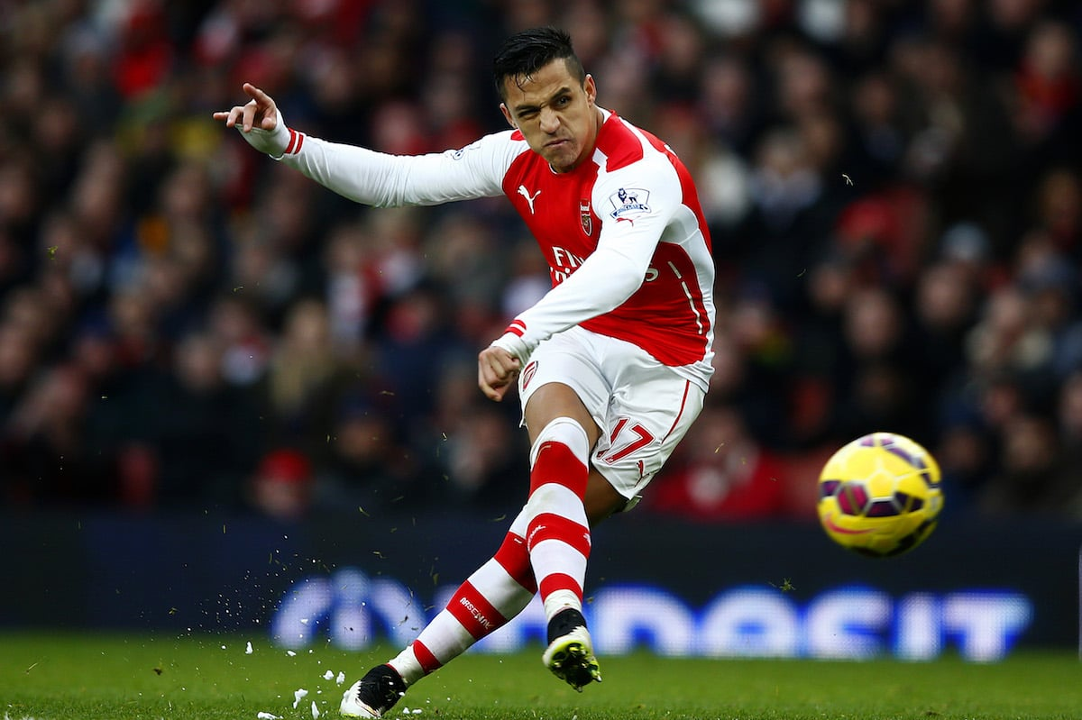 Alexis Sanchez of Arsenal scores his team's third goal during the Barclays Premier League match between Arsenal and Stoke City