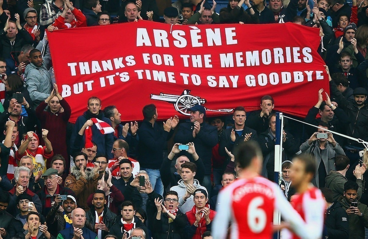 Arsenal fans hold up a banner for Arsene Wenger, manager of Arsenal during the Barclays Premier League.