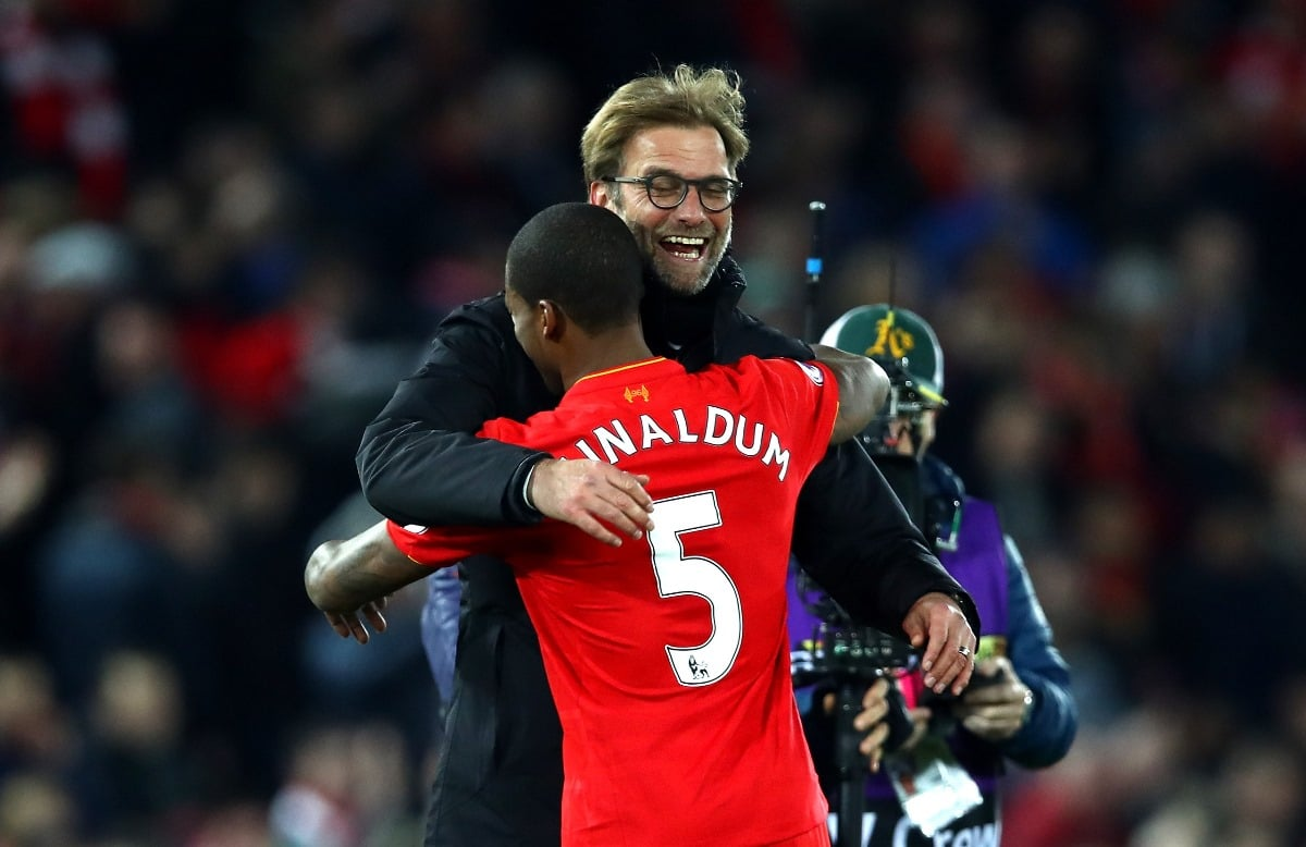 Liverpool manager Jurgen Klopp embraces Georginio Wijnaldum