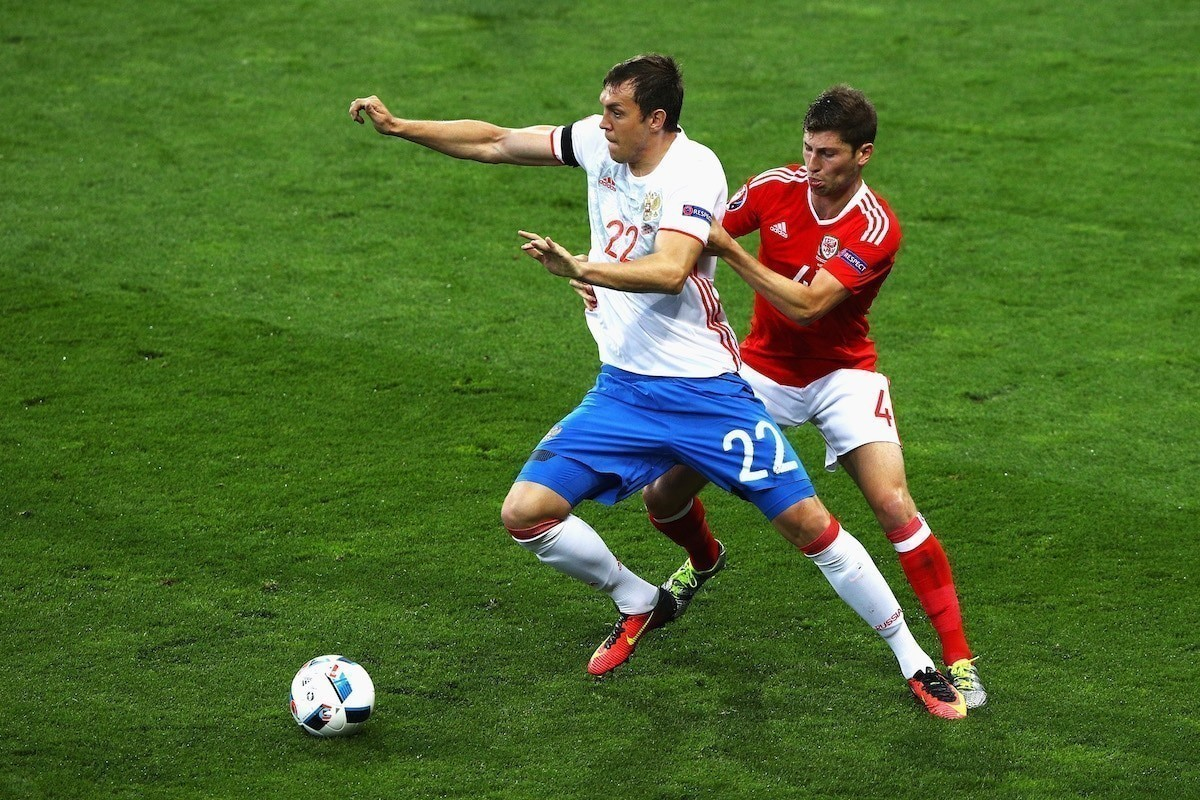 Wales' Ben Davies challenges Russia's Artem Dzyuba at the 2016 European Championships