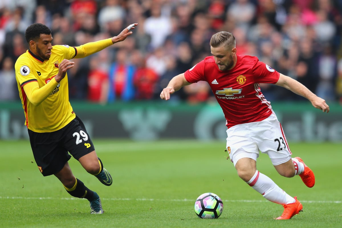 Luke Shaw of Manchester United (R) takes the ball past Etienne Capoue of Watford