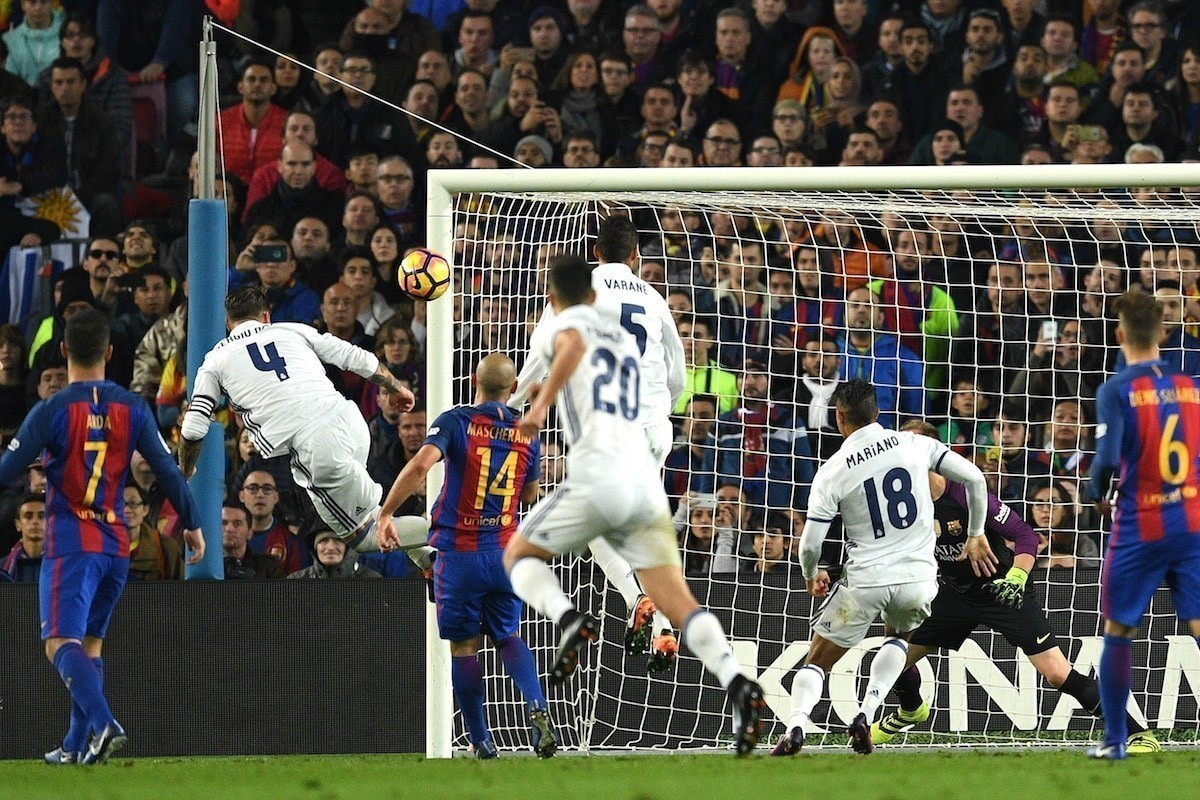 Sergio Ramos of Real Madrid heads to score his team's first goal during the La Liga match between FC Barcelona and Real Madrid