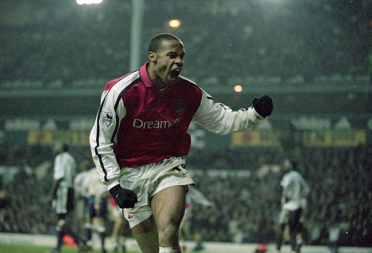 Arsenal striker Thierry Henry celebrates scoring against Tottenham Hotspur in the Premier League