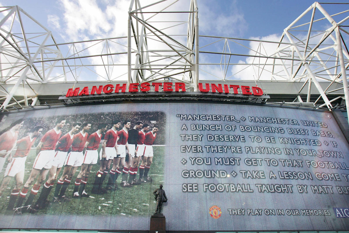 A mural showing Manchester United's team of 1958 and the lyrics of a club song about Matt Busby's Babes is pictured on the East Stand at Old Trafford