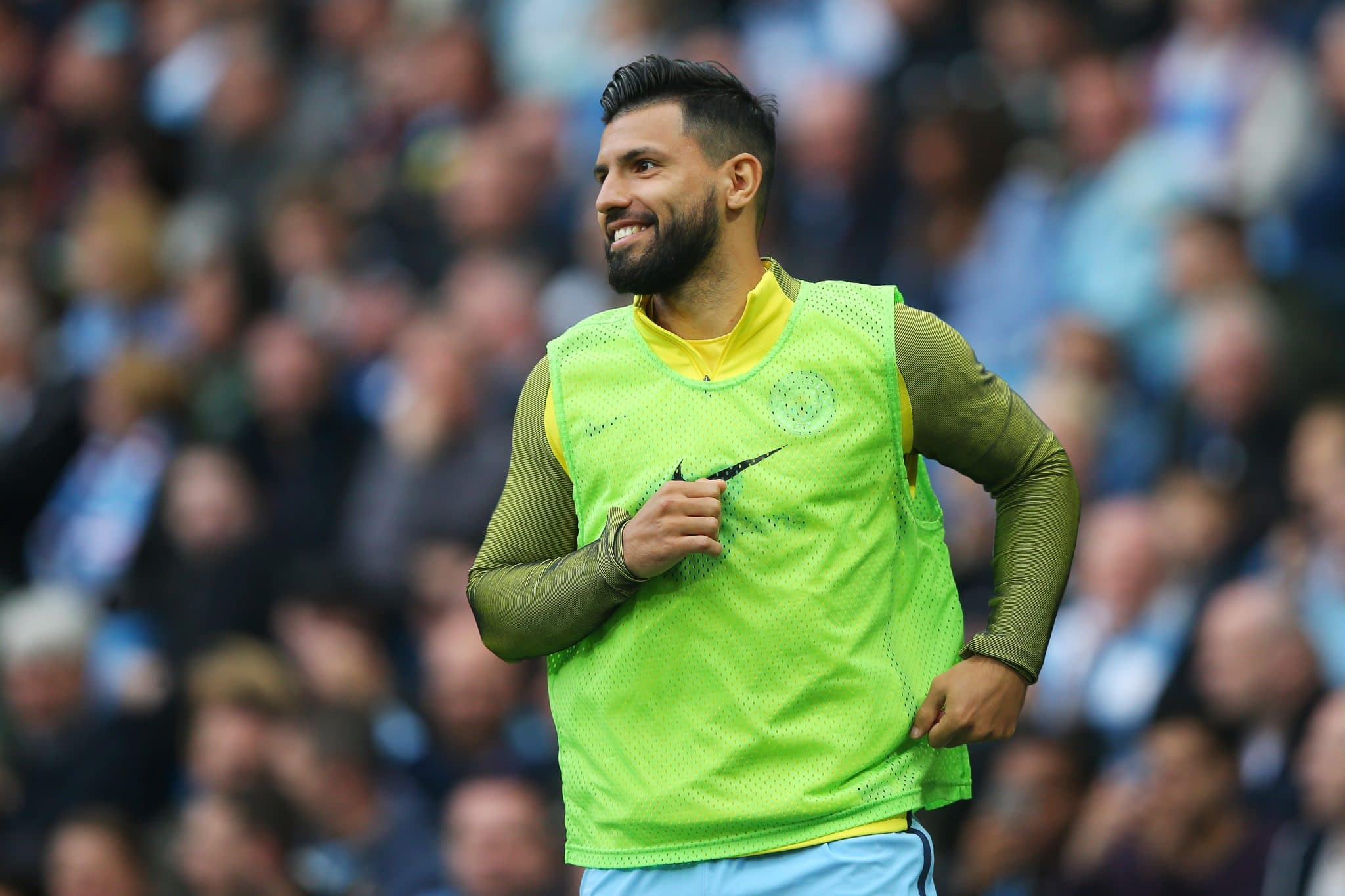 Manchester City striker Sergio Aguero warms up against Leicester City in the Premier League