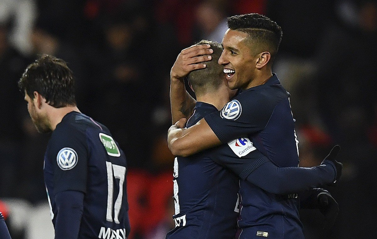 Paris Saint-Germain's Brazilian defender Marquinhos (R) is congratuled by teammates after scoring a goal during the French Cup semi-final match between Paris Saint-Germain and Monaco
