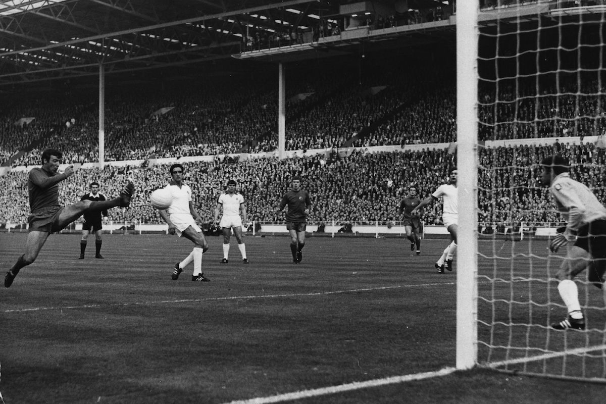 Manchester United inside forward, David Sadler, shoots at goal in the European Cup Final against, Portuguese side, Benfica at Wembley Stadium