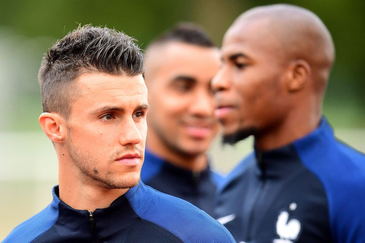 France's defender Sebastien Corchia (L) and defender Djibril Sidibe look on during a training session in Clairefontaine