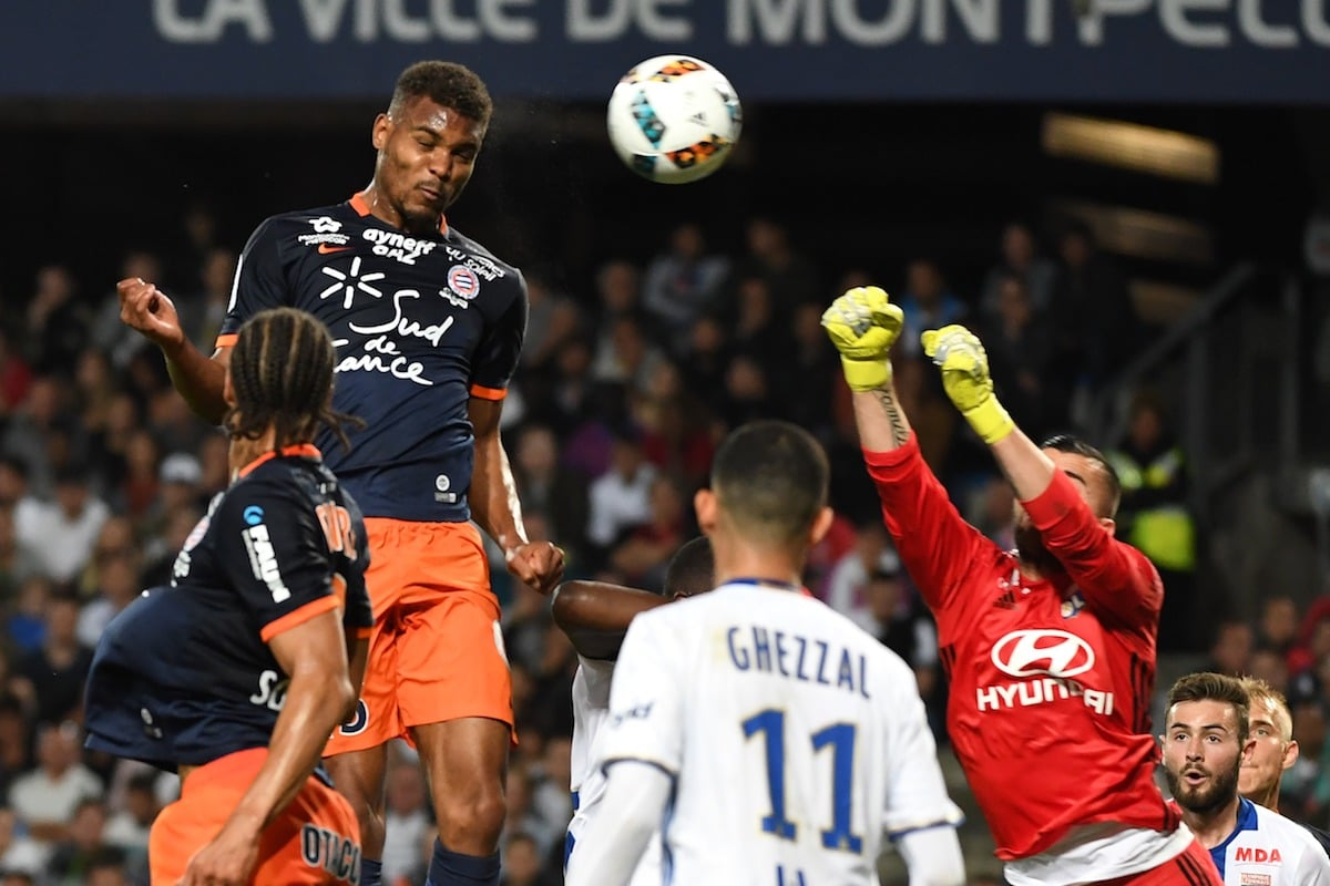 Montpellier's French forward Steve Mounie (L) scores a goal during the French L1 football match between Montpellier (MHSC) and Lyon (OL)