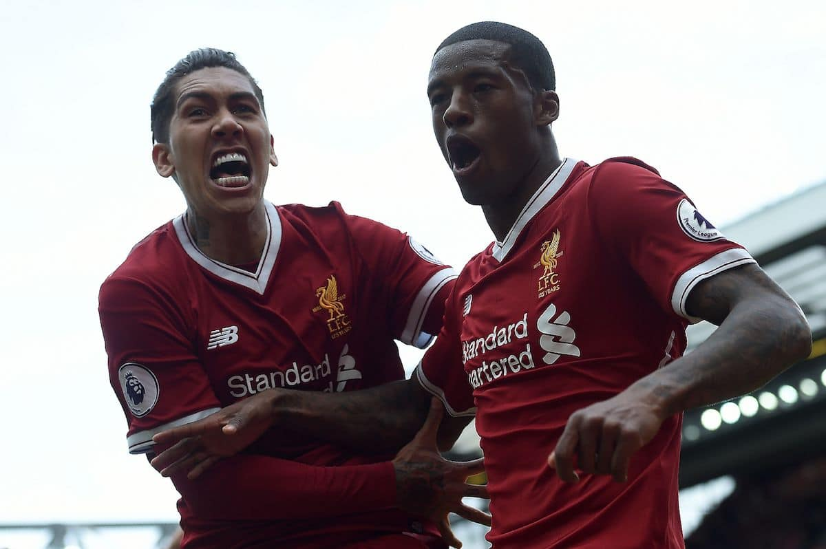 Liverpool's Roberto Firmino and Gini Wijnaldum celebrate in Liverpool's new kit