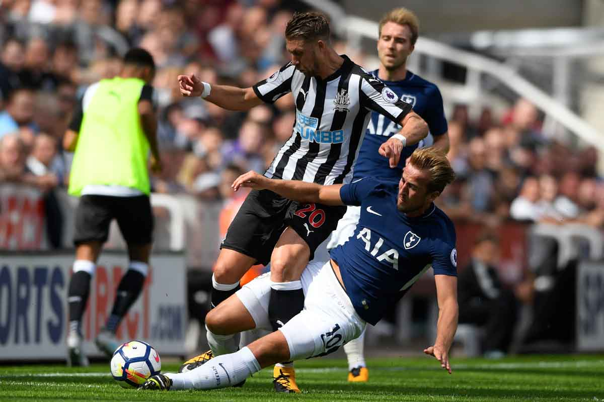 Florian Lejeune being tackled by Harry Kane