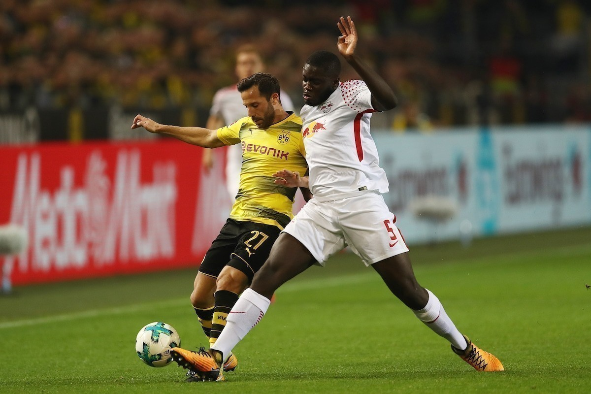 Gonzalo Castro of Dortmund (l) fights for the ball with Dayot Upamecano of Leipzig during the Bundesliga match between Borussia Dortmund and RB Leipzig