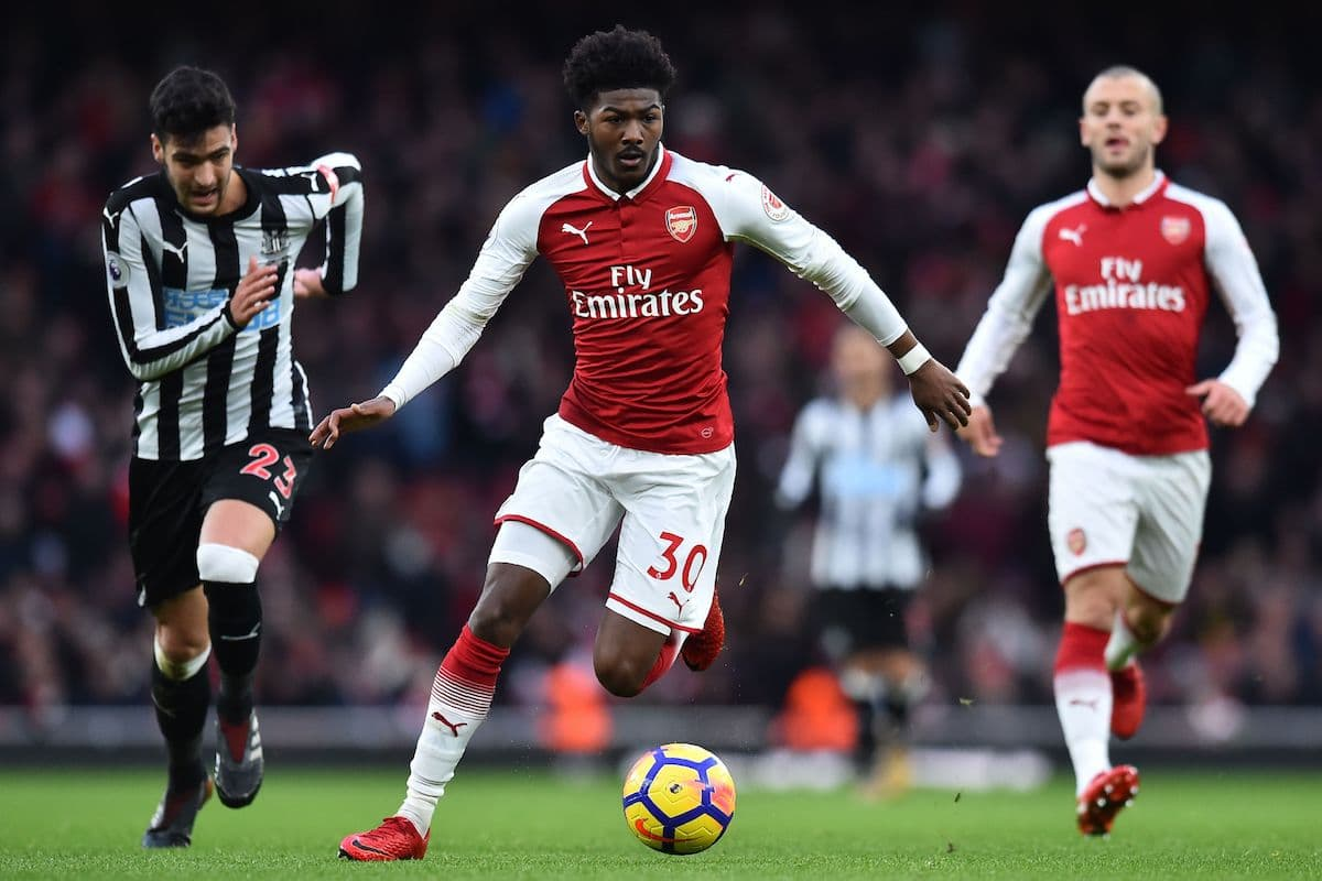 Arsenal's English midfielder Ainsley Maitland-Niles runs with the ball during the English Premier League football match between Arsenal and Newcastle United