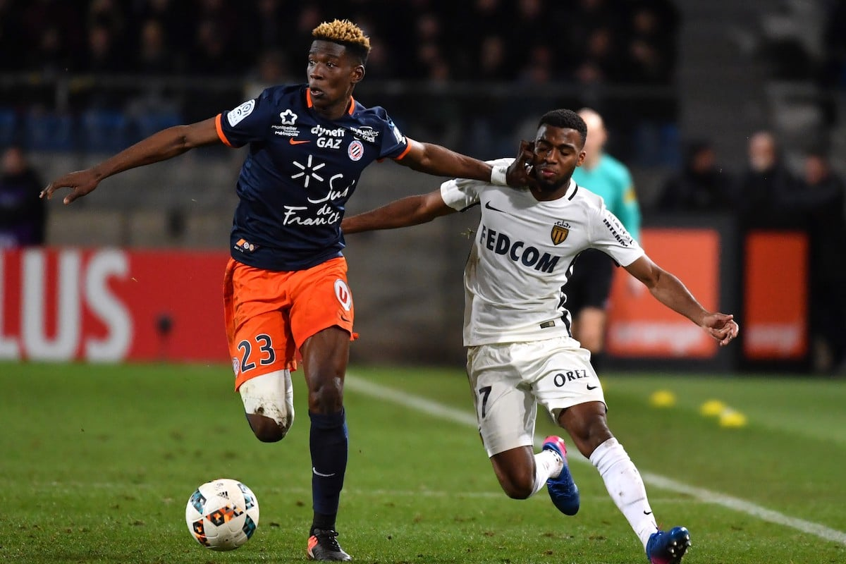 Montpellier's French defender Nordi Mukiele (L) vies with Monaco's French midfielder Thomas Lemar