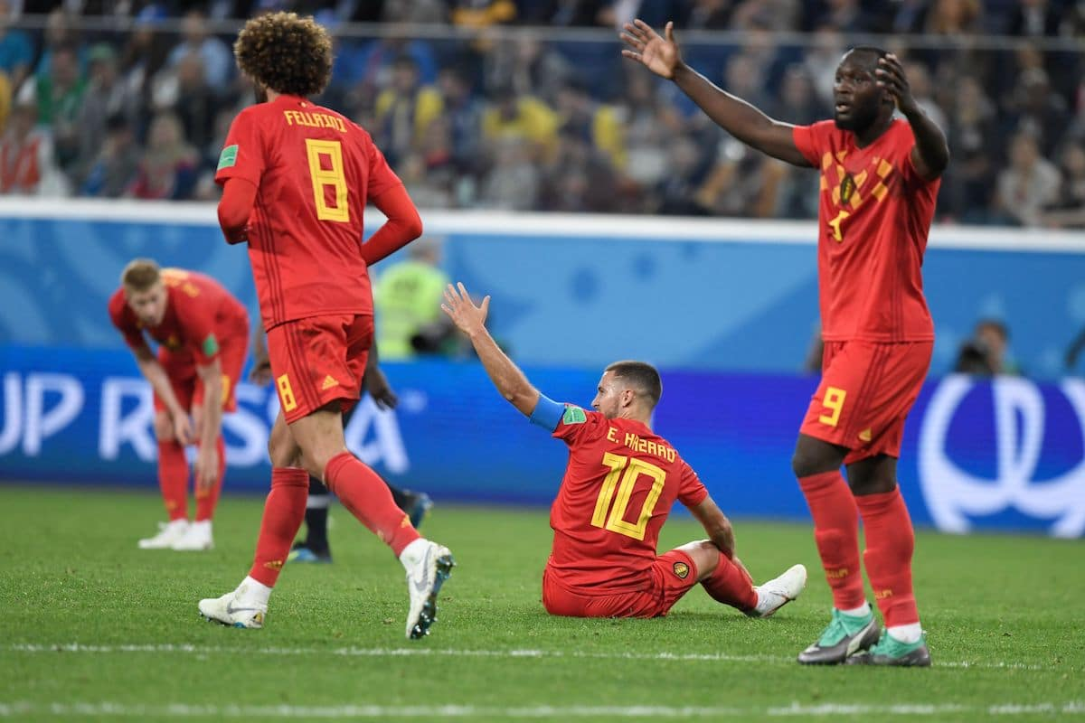 Belgium's forward Eden Hazard (C) reacts after a tackle during the Russia 2018 World Cup semi-final football match between France and Belgium