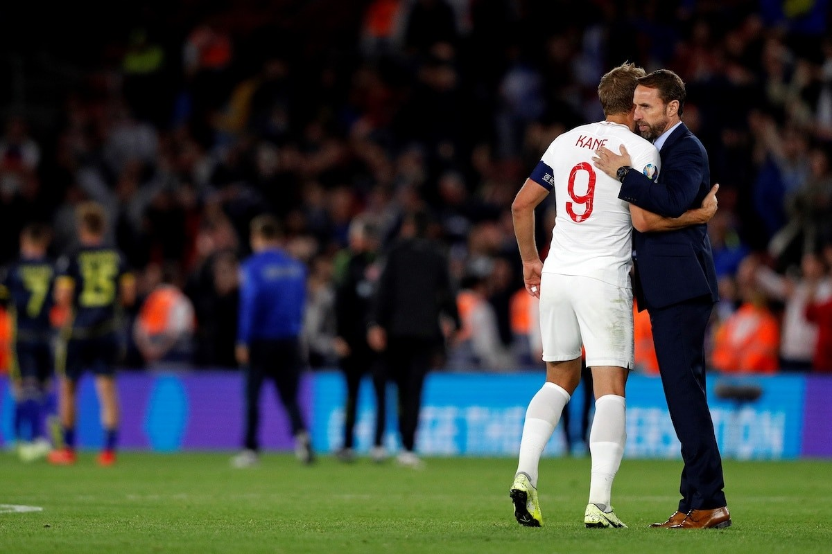Tottenham Hotspur forward Harry Kane embraces England manager Gareth Southgate